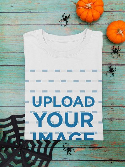 Mockup of a Folded T-Shirt Featuring Halloween Decor Items m100