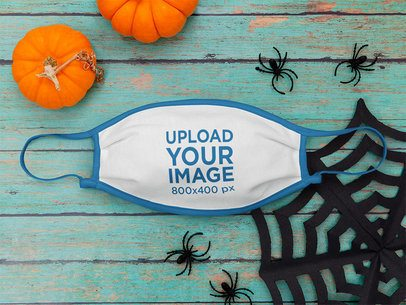 Mockup of a Face Mask Surrounded by Halloween Decor m115