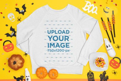 Mockup of a Crewneck Sweatshirt Surrounded by Halloween Decorations m98
