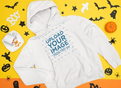 Mockup of a Flat Laid Pullover Hoodie Surrounded by Halloween Decor m90