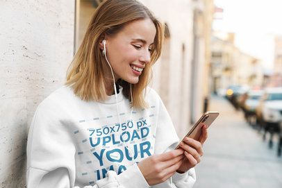 Sweatshirt Mockup of a Happy Woman Listening to Music on the Street 39824-r-el2