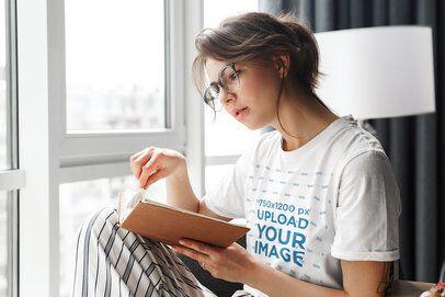 T-Shirt Mockup of a Woman Reading a Book at Home 39551-r-el2