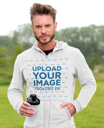 Mockup of a Bearded Athlete Posing with a Hoodie at a Park 40185-r-el2