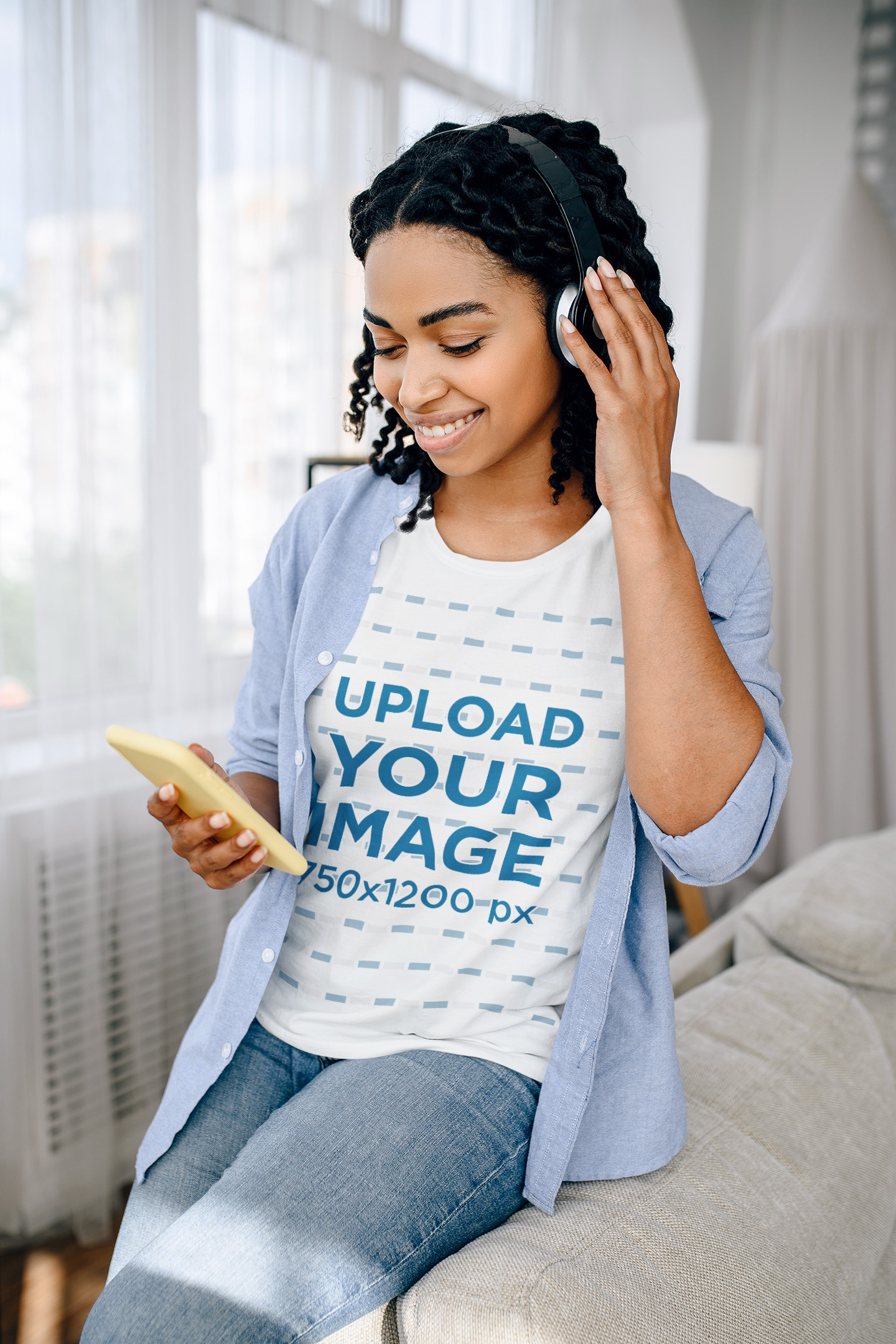 Tee Mockup of a Woman at Home Listening to Music on Her Phone 39257-r-el2
