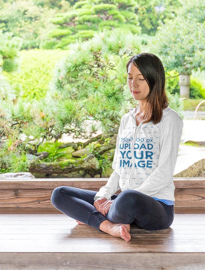 Mockup of a Woman Meditating in a Full-Zip Hoodie 42202-r-el2