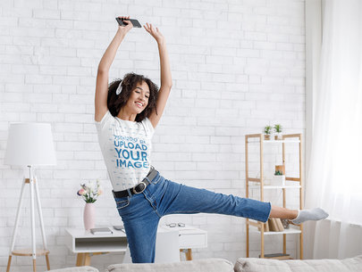 T-Shirt Mockup Featuring a Young Happy Woman Dancing at Home 43236-r-el2