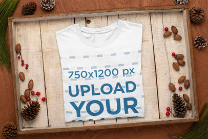Mockup of a T-Shirt Neatly Folded Inside a Christmas-Decorated Box m160