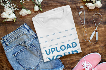 Mockup of a Folded T-Shirt Featuring Some Jeans and Flowers 41400-r-el2