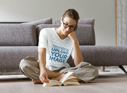 Mockup of a Woman with a Heather Tee Reading on the Floor 42016-r-el2