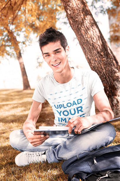 T-Shirt Mockup of a College Student Sitting on the Grass 40918-r-el2