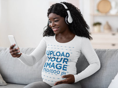 Mockup of a Pregnant Woman with a Long-Sleeve Tee Taking a Selfie 44668-r-el2