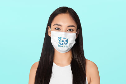 Face Mask Mockup of a Long-Haired Woman with a Customizable Backdrop 44522-r-el2