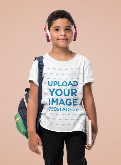T-Shirt Mockup of a Kid with School Articles Standing at a Studio 44445-r-el2