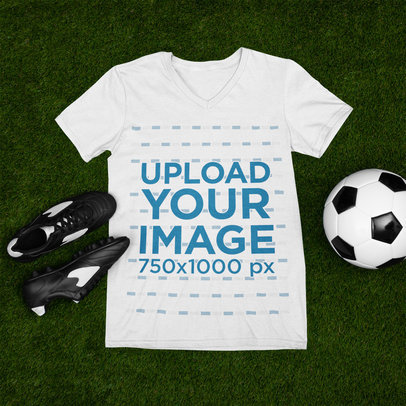 Mockup of a V-Neck Tee Flat Laid by a Soccer Ball and Cleats m373