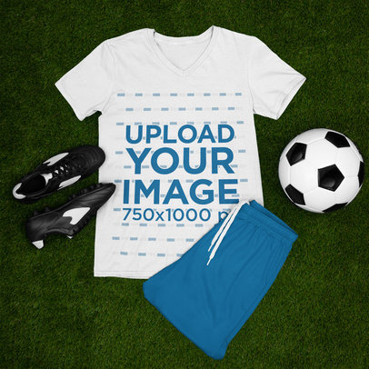 Mockup Featuring a T-Shirt Laid on a Soccer Field m374