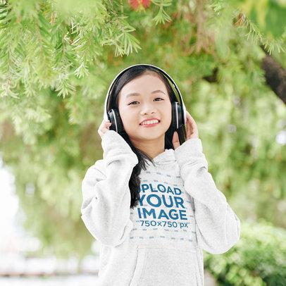 Pullover Hoodie Mockup Featuring a Teenage Girl Listening to Music 44477-r-el2
