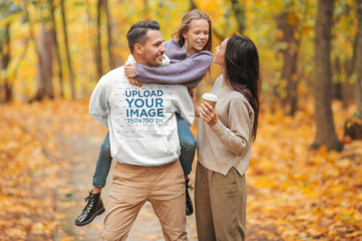 Hoodie Mockup of a Man Walking With His Family in the Forest 44624-r-el2