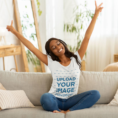 T-Shirt Mockup Featuring a Joyful Woman Listening to Music on Her Couch 44466-r-el2