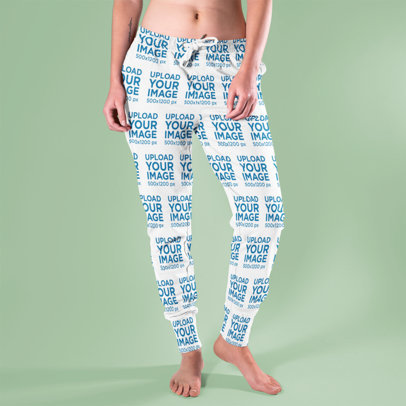 Mockup of a Woman Wearing Sublimated Sweatpants in a Studio 15586a