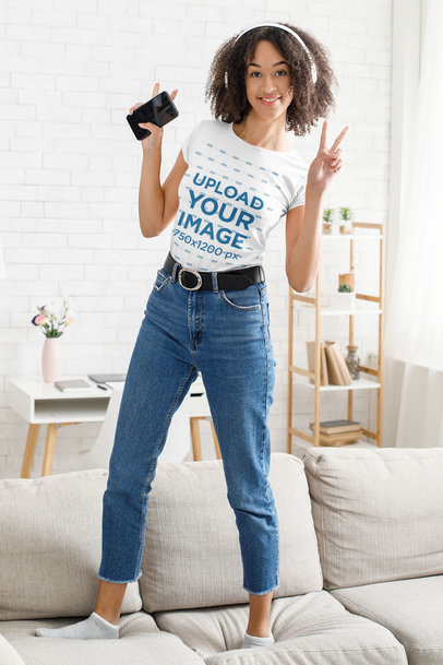 T-Shirt Mockup of a Happy Woman Dancing on the Couch 44654-r-el2