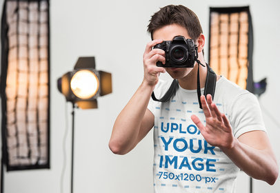 T-Shirt Mockup of a Man Taking a Photograph with a Professional Camera 44956-r-el2