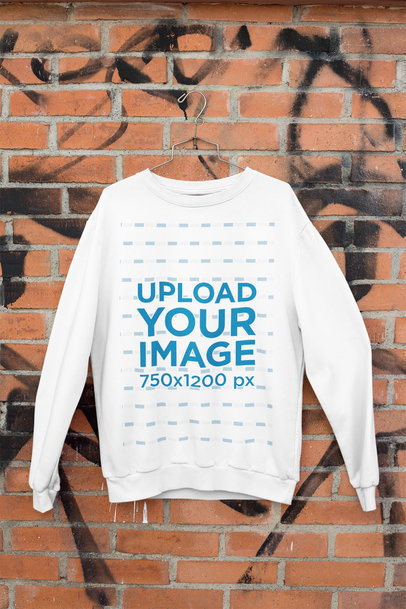 Mockup of a Sweatshirt Hanging Against a Brick Wall m462
