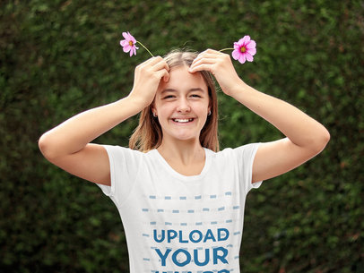 T-Shirt Mockup of a Teenager Posing with Flowers in Her Hair 45059-r-el2
