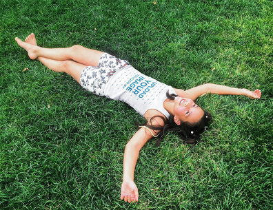 Tank Top Mockup Featuring a Smiling Woman Lying on the Grass 45081-r-el2