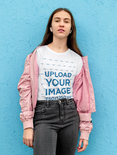 T-Shirt Mockup of a Young Woman Leaning on a Blue Wall 45075-r-el2