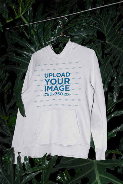 Mockup of a Pullover Hoodie Surrounded by Tropical Plants m511