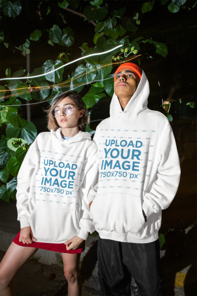 Hoodie Mockup of a Man and a Woman Looking Drowsy at a Party M556