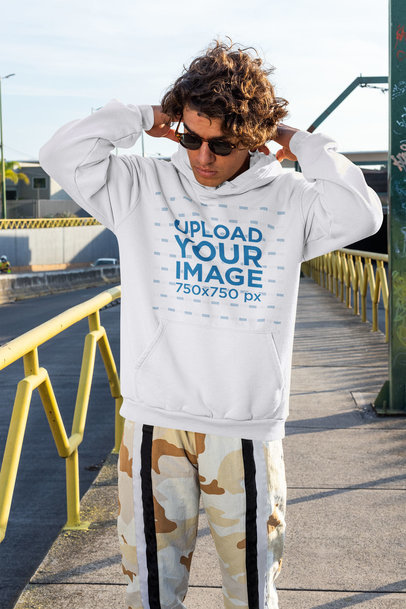 Streetwear-Styled Hoodie Mockup Featuring a Man on the Street m522