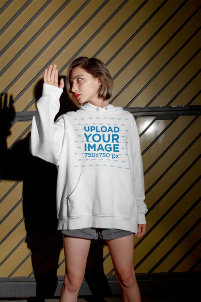 Hoodie Mockup of a Short Haired Woman Looking at Her Shadow m546
