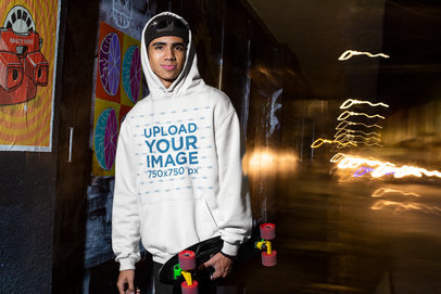 Hoodie Mockup Featuring a Skater on the Street M568