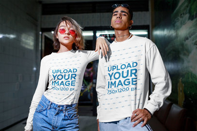 Mockup of a Man Wearing a Sweatshirt and a Woman Wearing a Long Sleeve Tee m559