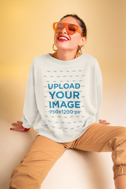 Sweatshirt Mockup Featuring a Woman with Trendy Sunglasses at a Studio M639