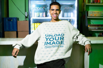 Mockup of a Man with an Oversized Sweatshirt Posing in a Bar m575