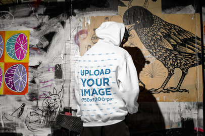 Mockup of the Back of a Man Wearing a Hoodie in a Dark Urban Scenario m567
