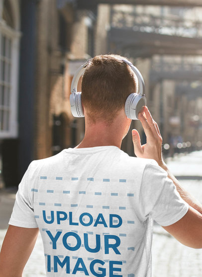 T-Shirt Mockup of a Man Walking Down The Street with Headphones On 45303-r-el2
