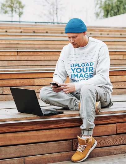 Sweatshirt Mockup of a Man Working Outside with His Laptop 45331-r-el2