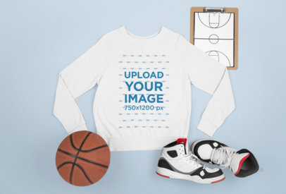 Flat Laid Sweatshirt Mockup Featuring a Basketball Ball m663