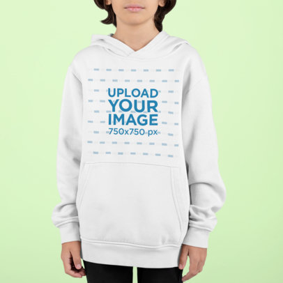 Pullover Hoodie Mockup Featuring a Kid Standing Against a Customizable Background m854