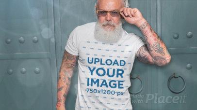 Parallax Video of a Tattooed Senior Man Wearing a T-Shirt 2520