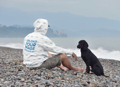 Hoodie Mockup of a Man Sitting at a Beach with His Dog 45630-r-el2