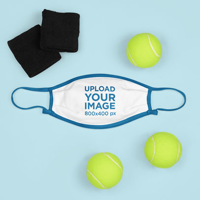 Mockup of a Face Mask Surrounded by Tennis Balls m681