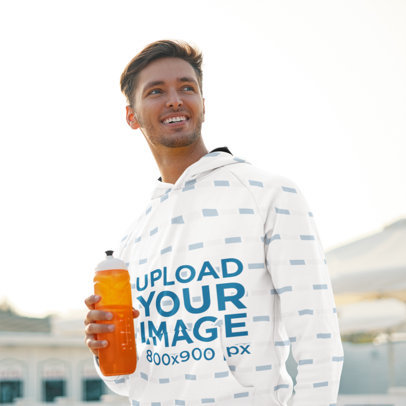 Pullover Hoodie Mockup Featuring a Man with an Energy Drink 45249-r-el2