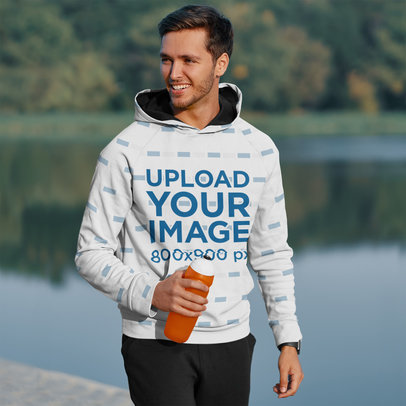 Mockup of a Man with a Pullover Hoodie Rehydrating Himself 45248-r-el2
