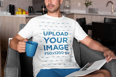 T-Shirt Mockup of a Man Drinking Coffee at Home m778