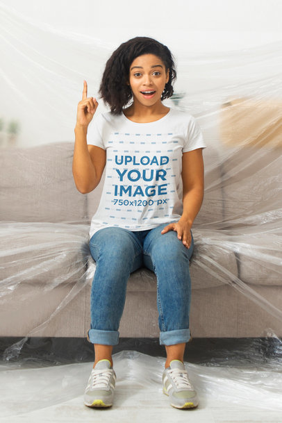 T-Shirt Mockup of a Woman Sitting on a Covered Couch 45533-r-el2