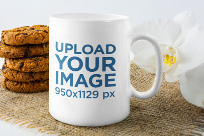 Mockup of an 11 oz Coffee Mug with a Flower and Some Cookies 45396-r-el2